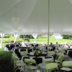 Inside Century Tent with Chandelier Tables Chairs Pole Covers